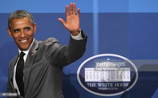 S President Barack Obama waves goodbye after delivering remarks during the White House Summit On Working Families at the Omni Shoreham hotel June 23...