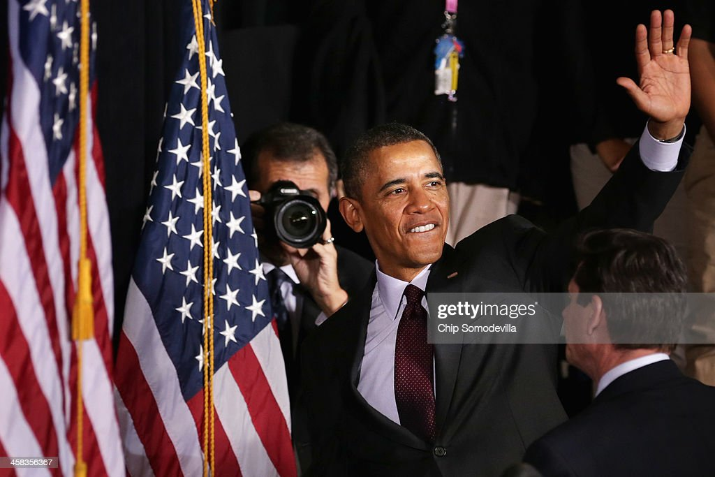 U.S. President <a gi-track='captionPersonalityLinkClicked' href=/galleries/search?phrase=Barack+Obama&family=editorial&specificpeople=203260 ng-click='$event.stopPropagation()'>Barack Obama</a> waves goodbye as White House Photographer Pete Souza takes photos after Obama delivered remarks about the ConnectED program at Buck Lodge Middle School February 4, 2014 in Adelphi, Maryland. As part of the president's ConnectED program, Obama has tasked the Federal Communications Commission to help to build high-speed digital connections to America's schools and libraries, with the goal of getting 99-percent of American students to next-generation broadband and wireless technology within five years.