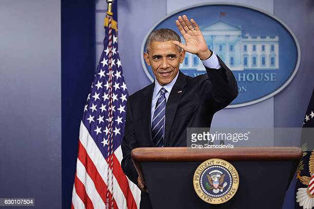 S President Barack Obama waves goodbye at the conclusion of a news conference in the Brady Press Briefing Room at the White House December 16 2016 in...