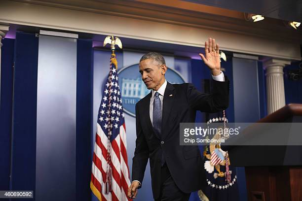 S President Barack Obama waves goodbye to reporters after his last news conference of the year in the Brady Press Briefing Room at the White House...