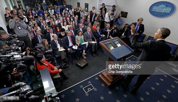 S President Barack Obama waves goodbye to reporters after holding a news conference in the Brady Press Briefing Room at the White House April 30 2013...