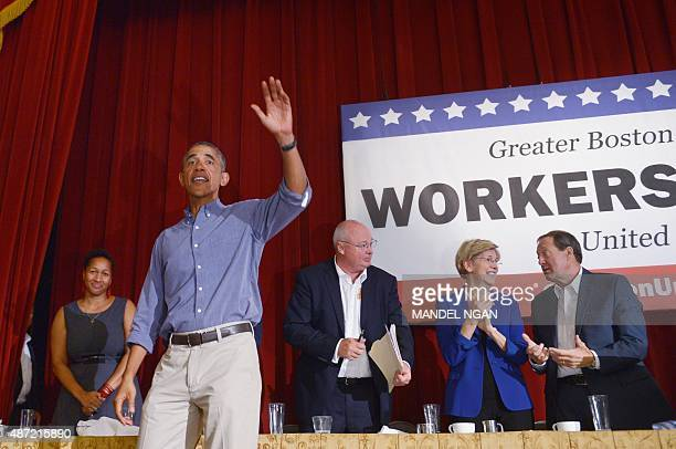 US President Barack Obama waves to attendees after addressing the Greater Boston Labor Council Labor Day Breakfast September 7 2015 in Boston...