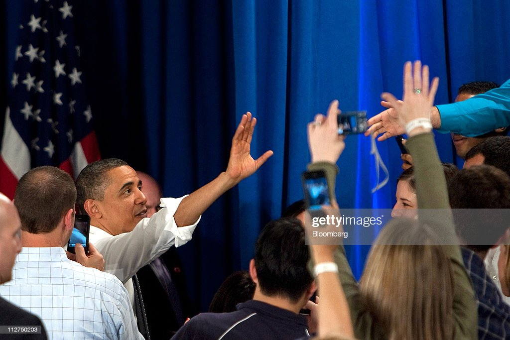 U.S. President <a gi-track='captionPersonalityLinkClicked' href=/galleries/search?phrase=Barack+Obama&family=editorial&specificpeople=203260 ng-click='$event.stopPropagation()'>Barack Obama</a> waves to attendees after speaking at a town hall event at Facebook Inc. headquarters in Palo Alto, California, U.S., on Wednesday, April 20, 2011. Obama said members of both political parties in Washington need to work together to start reducing the nation's budget deficit in a 'balanced way.' Photographer: David Paul Morris/Bloomberg via Getty Images