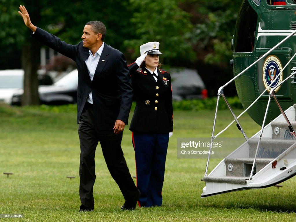 U.S. President Barack Obama waves to guests while walking across the White House South Lawn after arriving from an overnight trip to the Gulf Coast June 15, 2010 in Washington, DC. This was Obama's fourth trip to the region affected by the BP Deepwater Horizon explosion and oil spill since the disaster started eight weeks ago. Obama will address the nation on television tonight about the spill.