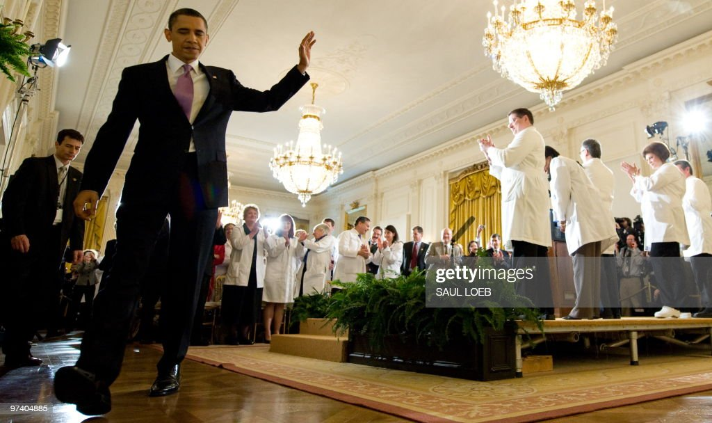 US President <a gi-track='captionPersonalityLinkClicked' href=/galleries/search?phrase=Barack+Obama&family=editorial&specificpeople=203260 ng-click='$event.stopPropagation()'>Barack Obama</a> waves to healthcare professionals after speaking about his final strategy for moving forward with health insurance reform in the East Room of the White House in Washington, DC, March 3, 2010. AFP PHOTO / Saul LOEB