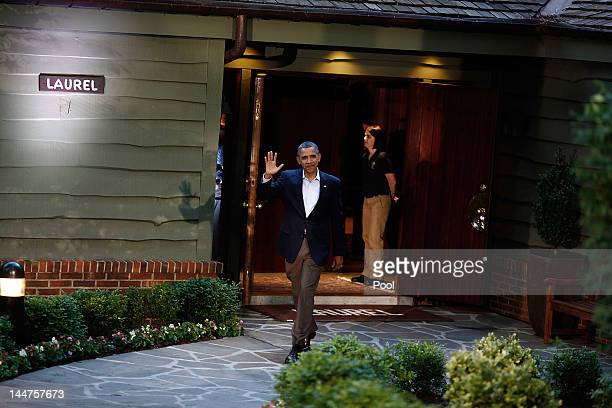 S President Barack Obama waves to members of the media before greeting G8 leaders in front of Laurel Lodge at Camp David during the 2012 G8 Summit on...