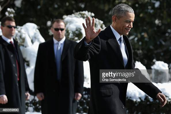 S President Barack Obama waves to reporters as he leaves the White House before boarding the Marine One helicopter on the South Lawn March 6 2015 in...