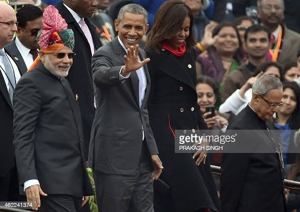 US President Barack Obama waves to spectators as he leaves with US First Lady Michelle Obama Indian Prime Minister Narendra Modi and Indian President...