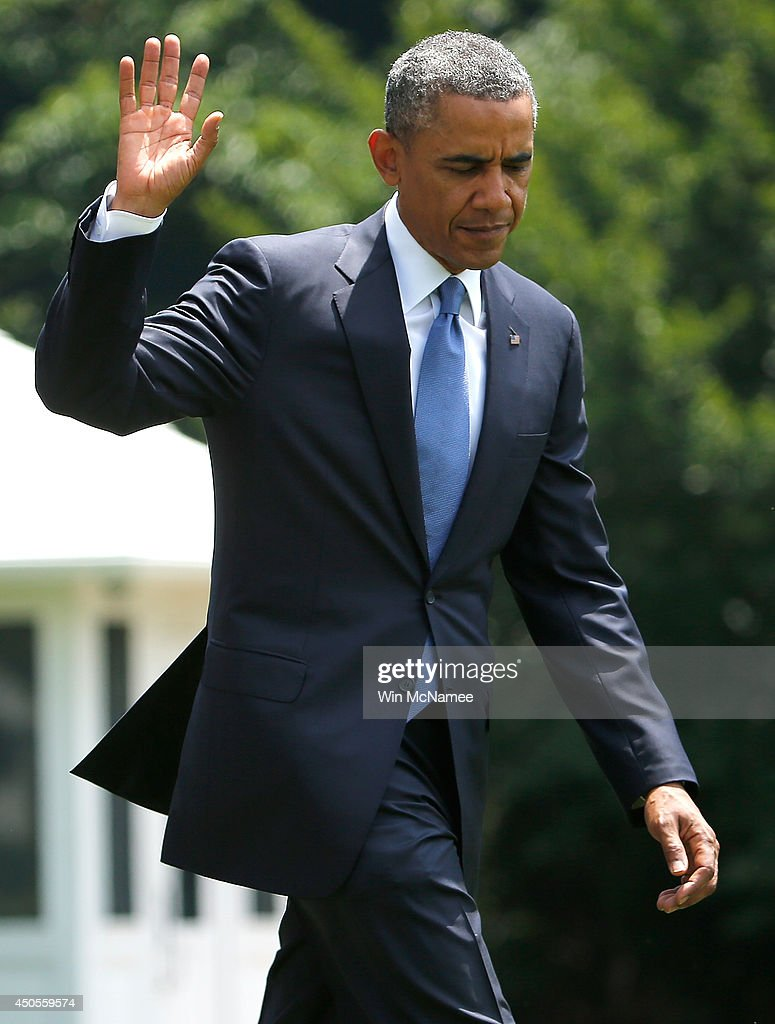 U.S. President Barack Obama waves to spectators watching his departure after he made a statement on the situation in Iraq from the south lawn of the White House June 13, 2014 in Washington, DC. Obama said he will make a decision in the 'days ahead' about the use of American military power to aid the Iraqi government in its battle against Islamic insurgents.