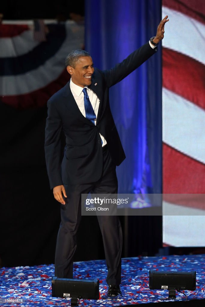 U.S. President <a gi-track='captionPersonalityLinkClicked' href=/galleries/search?phrase=Barack+Obama&family=editorial&specificpeople=203260 ng-click='$event.stopPropagation()'>Barack Obama</a> waves to supporters after his victory speech at McCormick Place November 6, 2012 in Chicago, Illinois. Obama won reelection against Republican candidate, former Massachusetts Governor Mitt Romney.