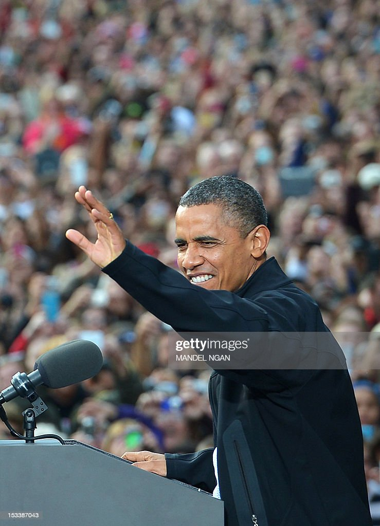US President Barack Obama waves to supporters as he arrives onto the stage for a campaign rally October 4, 2012 at the University of Wisconsin-Madison in Madison, Wisconsin. Obama returned to the campaign trail after taking part in the first presidential debate on October 3, 2012 in Denver. AFP PHOTO/Mandel NGAN