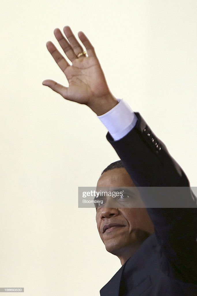 U.S. President <a gi-track='captionPersonalityLinkClicked' href=/galleries/search?phrase=Barack+Obama&family=editorial&specificpeople=203260 ng-click='$event.stopPropagation()'>Barack Obama</a> waves to the audience following his speech at the University of Yangon in Yangon, Myanmar, on Monday, Nov. 19, 2012. Obama hailed Myanmar's shift to democracy and urged more steps to increase freedom in the first visit to the former military regime by a U.S. president. Photographer: Dario Pignatelli/Bloomberg via Getty Images