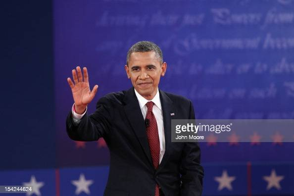 S President Barack Obama waves to the audience prior to the start of a town hall style debate at Hofstra University October 16 2012 in Hempstead New...