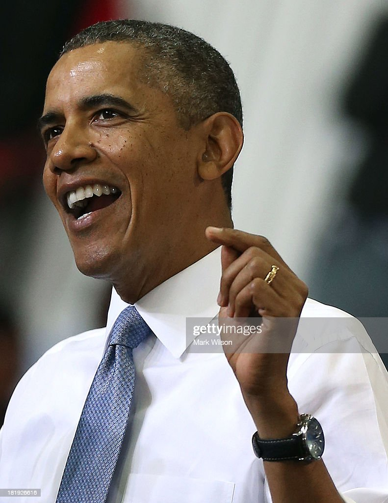 U.S. President <a gi-track='captionPersonalityLinkClicked' href=/galleries/search?phrase=Barack+Obama&family=editorial&specificpeople=203260 ng-click='$event.stopPropagation()'>Barack Obama</a> waves to the crowd after speaking about health care at the Prince Georges Community College, September 26, 2013 in Largo, Maryland. President Obama spoke about the benefits of the Affordable Healthcare Act (ObamaCare) that will become available next month.