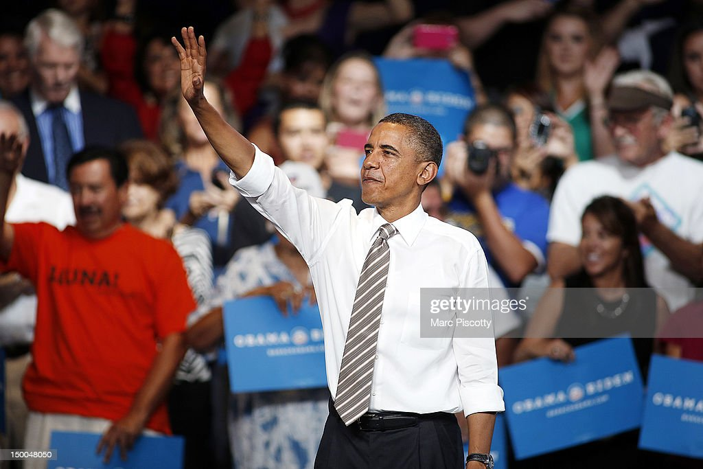 U.S. President <a gi-track='captionPersonalityLinkClicked' href=/galleries/search?phrase=Barack+Obama&family=editorial&specificpeople=203260 ng-click='$event.stopPropagation()'>Barack Obama</a> waves to the crowd after speaking during a campaign stop at the Palace of Agriculture on the Colorado State Fairgrounds August 9, 2012 in Pueblo, Colorado. Obama covered a number of topics including paying down our debt in a balanced way, job growth and creation and preventing a scheduled tax increase.
