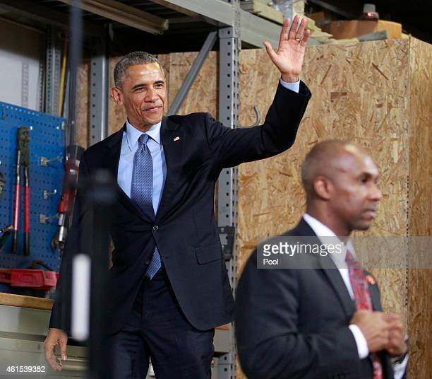 S President Barack Obama waves to the crowd as he approaches the podium for a speech at Cedar Falls Utilities on January 14 2015 in Cedar Falls Iowa...