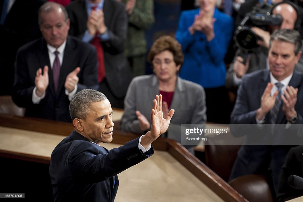U.S. President Barack Obama waves to the gallery following the State of the Union address to a joint session of Congress at the Capitol in Washington, D.C., U.S., on Tuesday, Jan. 28, 2014. President Barack Obama urged Congress to back two priorities for U.S. multinational corporations: broader authority for his administration to negotiate trade deals, and changes to immigration laws. Photographer: Pete Marovich/Bloomberg via Getty Images