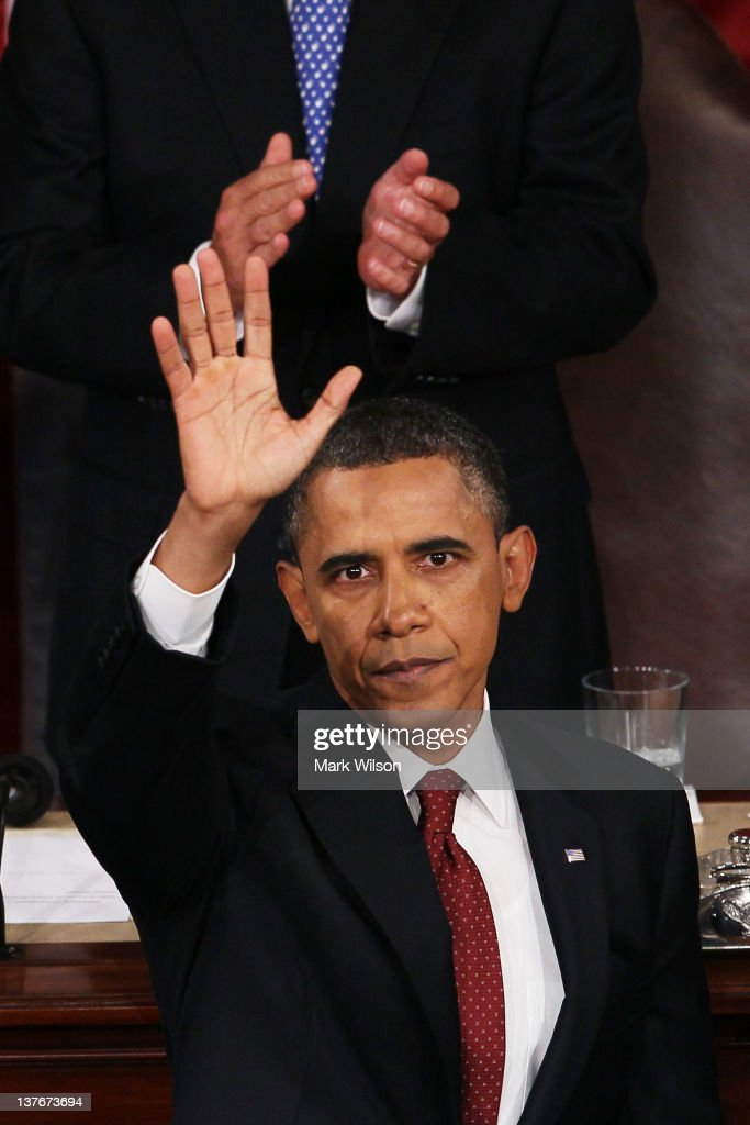 U.S. President <a gi-track='captionPersonalityLinkClicked' href=/galleries/search?phrase=Barack+Obama&family=editorial&specificpeople=203260 ng-click='$event.stopPropagation()'>Barack Obama</a> waves to the joint session of Congress after delivering his State of the Union address on January 24, 2012 in Washington, DC. Obama said the focal point his speech is the central mission of our country, and his central focus as president, including 'rebuilding an economy where hard work pays off and responsibility is rewarded.'