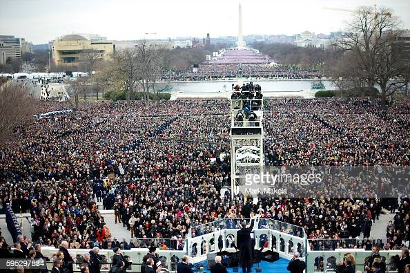 President Barack Obama waves to the masses after delivering the inaugural address during the 57th Inauguration in Washington DC on January 20 2013