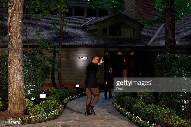S President Barack Obama waves to the media after greeting G8 leaders in front of Laurel Lodge at Camp David during the 2012 G8 Summit on Friday May...