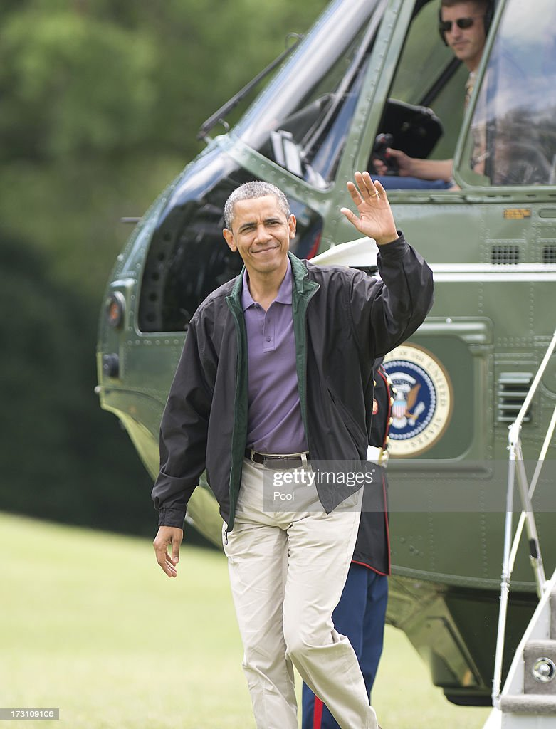 U.S. President Barack Obama waves to the media as he arrives on the South Lawn of the White House July 7, 2013 in Washington, D.C. Obama spent the holiday weekend at Camp David.