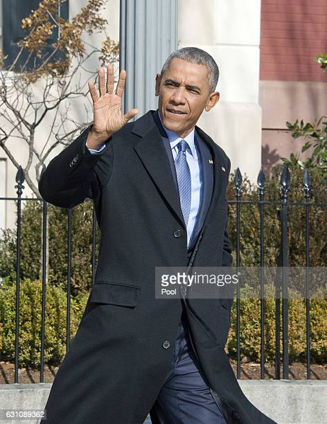 US President Barack Obama waves to the press pool as he departs Blair House to walk back to the White House following his interview with Vox on...