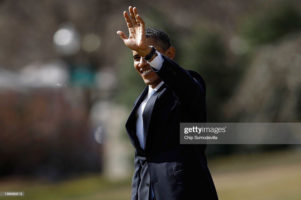 U.S. President <a gi-track='captionPersonalityLinkClicked' href=/galleries/search?phrase=Barack+Obama&family=editorial&specificpeople=203260 ng-click='$event.stopPropagation()'>Barack Obama</a> waves to visitors as he crosses the South Lawn of the White House before boarding Marine One February 23, 2012 in Washington, DC. Obama is traveling to Miami, Florida, to talk about his administration's energy and economic policies and to attend campaign fundraisers.