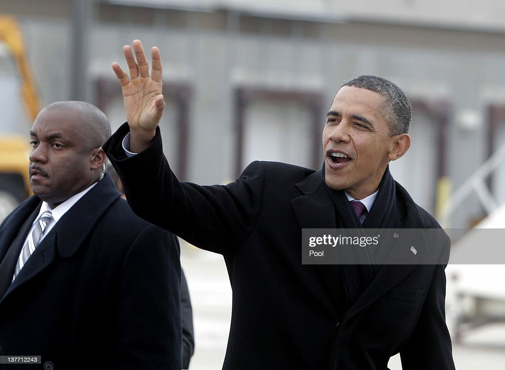 U.S. President <a gi-track='captionPersonalityLinkClicked' href=/galleries/search?phrase=Barack+Obama&family=editorial&specificpeople=203260 ng-click='$event.stopPropagation()'>Barack Obama</a> waves to well wishers after arriving at The Eastern Iowa Airport January 25, 2012 in Cedar Rapids, Iowa. Obama, who is on a three-day tour, spoke about manufacturing and the economy during the speech.