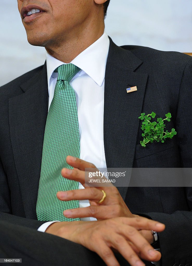 US President Barack Obama wears a green tie and with shamrock in his pocket during a meeting with Irish Prime Minister Enda Kenny in the Oval Office at the White House in Washington, DC, on March 19, 2013. The two leaders will be attending a luncheon on Capitol Hill later Tuesday. AFP PHOTO/Jewel Samad