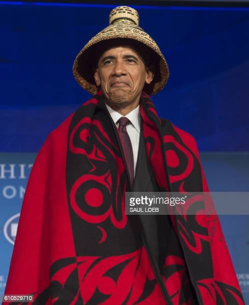President Barack Obama wears a traditional blanket and hat given to him during the 2016 White House Tribal Nations Conference at the Andrew W Mellon...