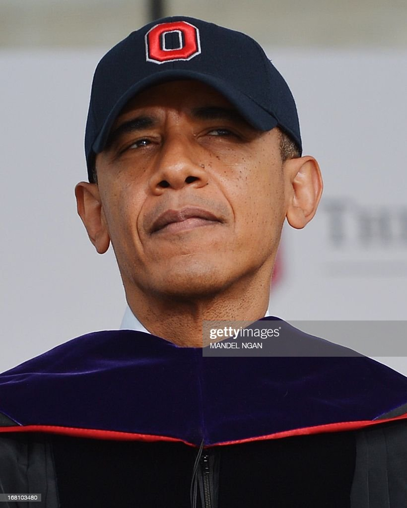US President Barack Obama wears an OSU baseball cap after receiving an honorary degree during the commencement ceremony at Ohio State University on May 5, 2013 in Columbus, Ohio. AFP PHOTO/Mandel NGAN