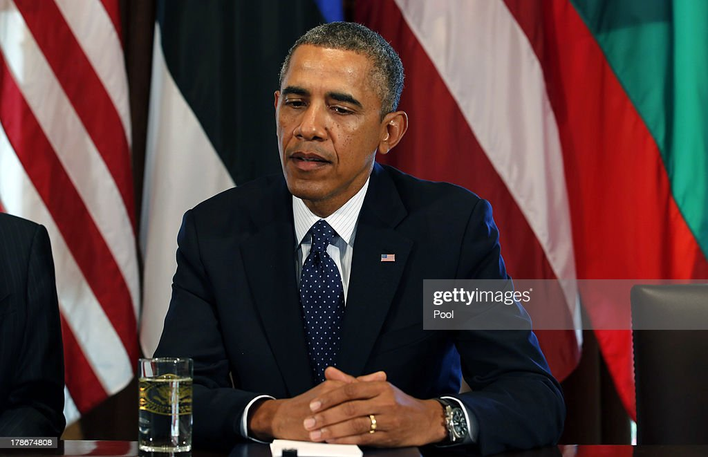 US President <a gi-track='captionPersonalityLinkClicked' href=/galleries/search?phrase=Barack+Obama&family=editorial&specificpeople=203260 ng-click='$event.stopPropagation()'>Barack Obama</a> welcomes President Toomas Hendrik Ilves of Estonia, President Dalia Grybauskaite of Lithuania, and President Andris Berzins of Latvia in the Cabinet Room of the White House August 30, 2013 in Washington, DC. A joint meeting was to be held that will highlight the transformations the Baltic States have undergone since restoring their independence two decades ago. President Obama spoke with the media about the ongoing situation in Syria.