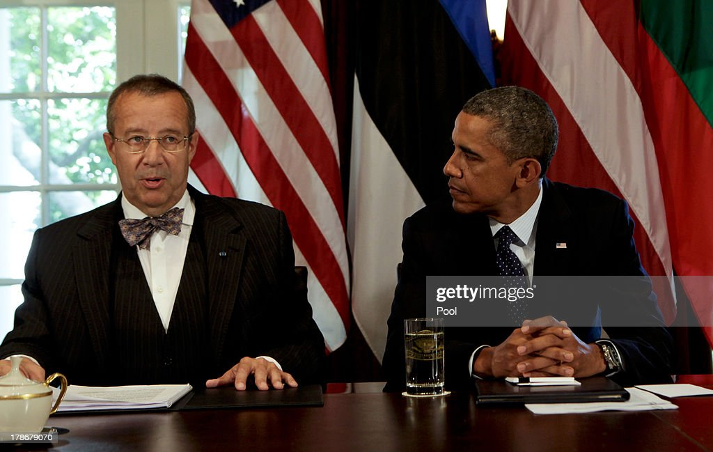 US President Barack Obama welcomes President Toomas Hendrik Ilves of Estonia along with President Dalia Grybauskaite of Lithuania and President Andris Berzins of Latvia (not seen) in the Cabinet Room of the White House August 30, 2013 in Washington, DC. A joint meeting was to be held that will highlight the transformations the Baltic States have undergone since restoring their independence two decades ago. President Obama spoke with the media about the ongoing situation in Syria.