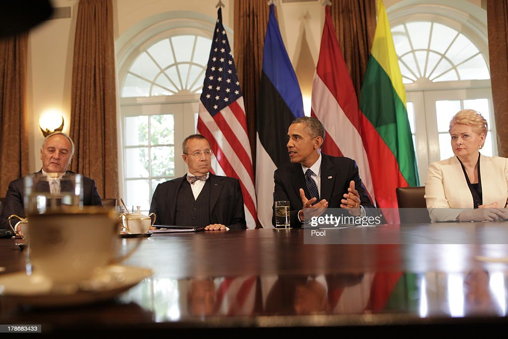US President Barack Obama welcomes President Toomas Hendrik Ilves of Estonia, President Dalia Grybauskaite of Lithuania, and President Andris Berzins of Latvia in the Cabinet Room of the White House August 30, 2013 in Washington, DC. A joint meeting was to be held that will highlight the transformations the Baltic States have undergone since restoring their independence two decades ago. President Obama spoke with the media about the ongoing situation in Syria.