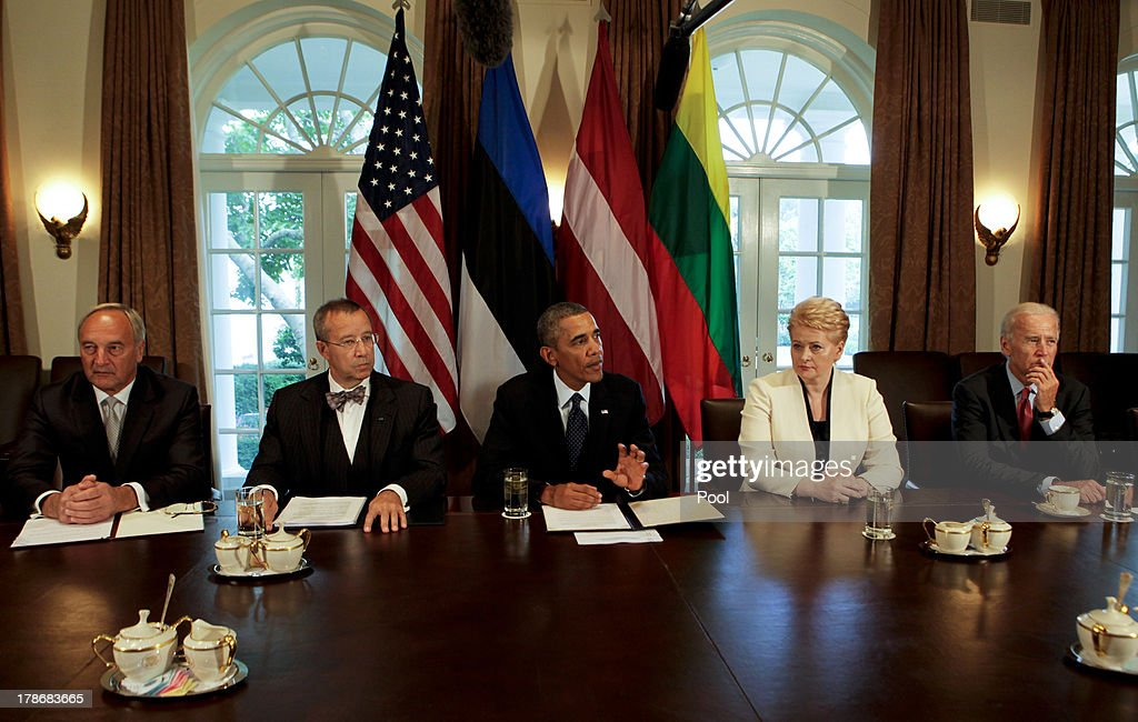 US President <a gi-track='captionPersonalityLinkClicked' href=/galleries/search?phrase=Barack+Obama&family=editorial&specificpeople=203260 ng-click='$event.stopPropagation()'>Barack Obama</a> welcomes President Toomas Hendrik Ilves of Estonia, President Dalia Grybauskaite of Lithuania, and President Andris Berzins of Latvia along with U.S. Vice President Joseph Biden in the Cabinet Room of the White House August 30, 2013 in Washington, DC. A joint meeting was to be held that will highlight the transformations the Baltic States have undergone since restoring their independence two decades ago. President Obama spoke with the media about the ongoing situation in Syria.