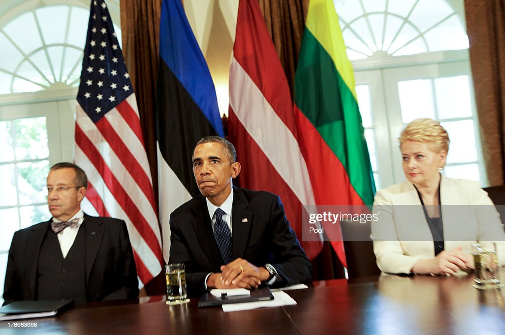US President Barack Obama welcomes President Toomas Hendrik Ilves of Estonia(L), President Dalia Grybauskaite of Lithuania(R), and President Andris Berzins of Latvia (not seen) in the Cabinet Room of the White House August 30, 2013 in Washington, DC. A joint meeting was to be held that will highlight the transformations the Baltic States have undergone since restoring their independence two decades ago. President Obama spoke with the media about the ongoing situation in Syria.