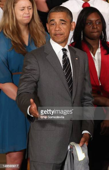 S President Barack Obama welcomes the 2012 NCAA Women's Basketball champion Baylor Bears in the East Room of the White House July 18 2012 in...