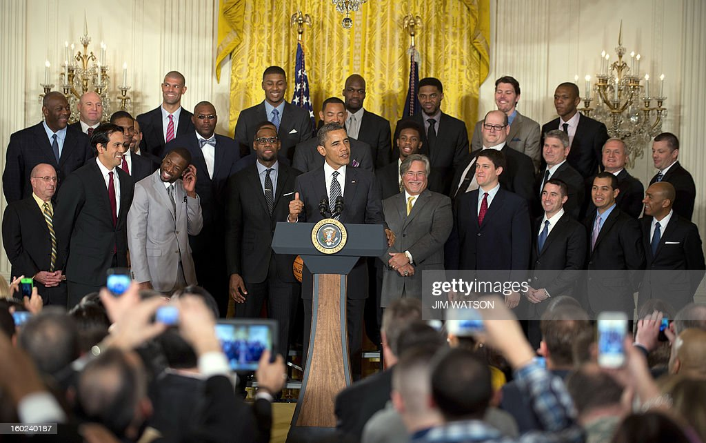 US President Barack Obama (C) welcomes the NBA Champion Miami Heat to the White House to honor the team and their 2012 NBA Championship victory in Washington, DC, January 28, 2013. AFP PHOTO/Jim WATSON