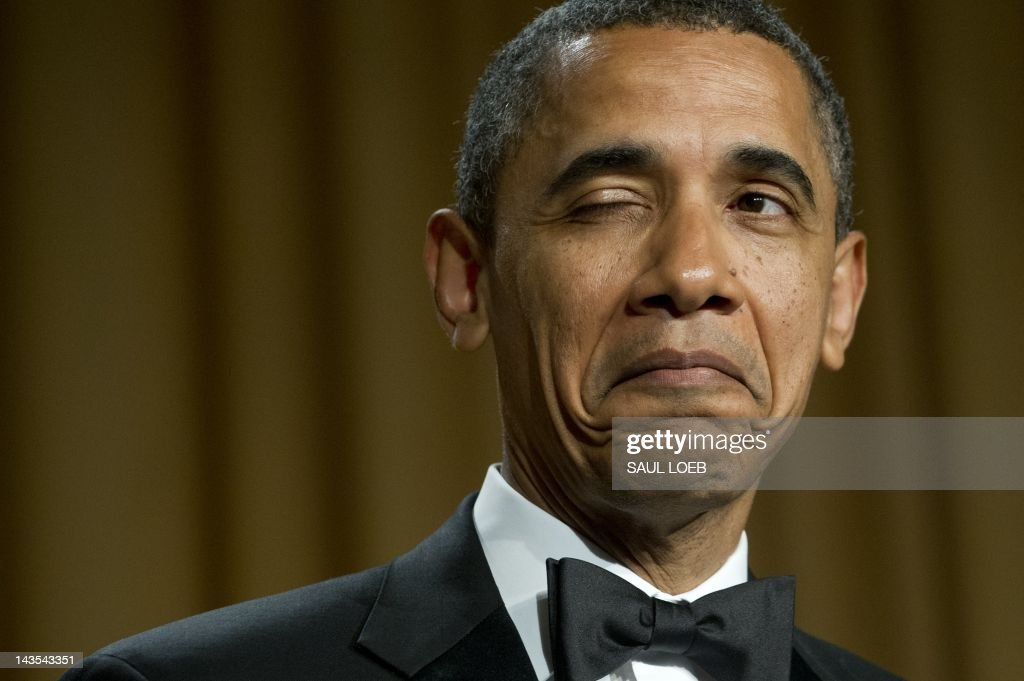 US President Barack Obama winks as he tells a joke about his place of birth during the White House Correspondents Association Dinner in Washington, DC, April 28, 2012. The annual event, which brings together US President Barack Obama, Hollywood celebrities, news media personalities and Washington correspondents, features comedian Jimmy Kimmel as the host. AFP PHOTO / Saul LOEB