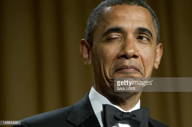 US President Barack Obama winks as he tells a joke about his place of birth during the White House Correspondents Association Dinner in Washington DC...