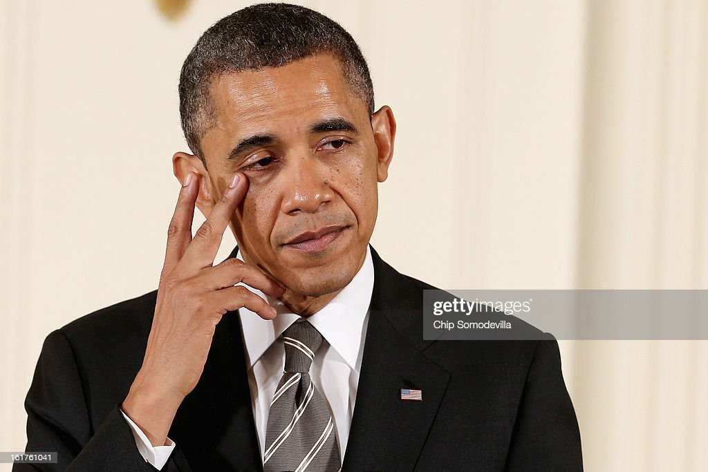 U.S. President <a gi-track='captionPersonalityLinkClicked' href=/galleries/search?phrase=Barack+Obama&family=editorial&specificpeople=203260 ng-click='$event.stopPropagation()'>Barack Obama</a> wipes a tear from the corner of his eye before presenting recepients with the 2012 Presidential Citizens Medal, the nation's second-highest civilian honor, in the East Room of the White House February 15, 2013 in Washington, DC. 'Their selflessness and courage inspire us all to look for opportunities to better serve our communities and our country,' Obama said about this year's recepients.