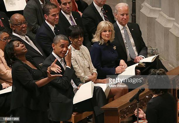 S President Barack Obama wipes away a tear while he and first lady Michelle Obama Dr Jill Biden and Vice President Joseph Biden listen to Michele...