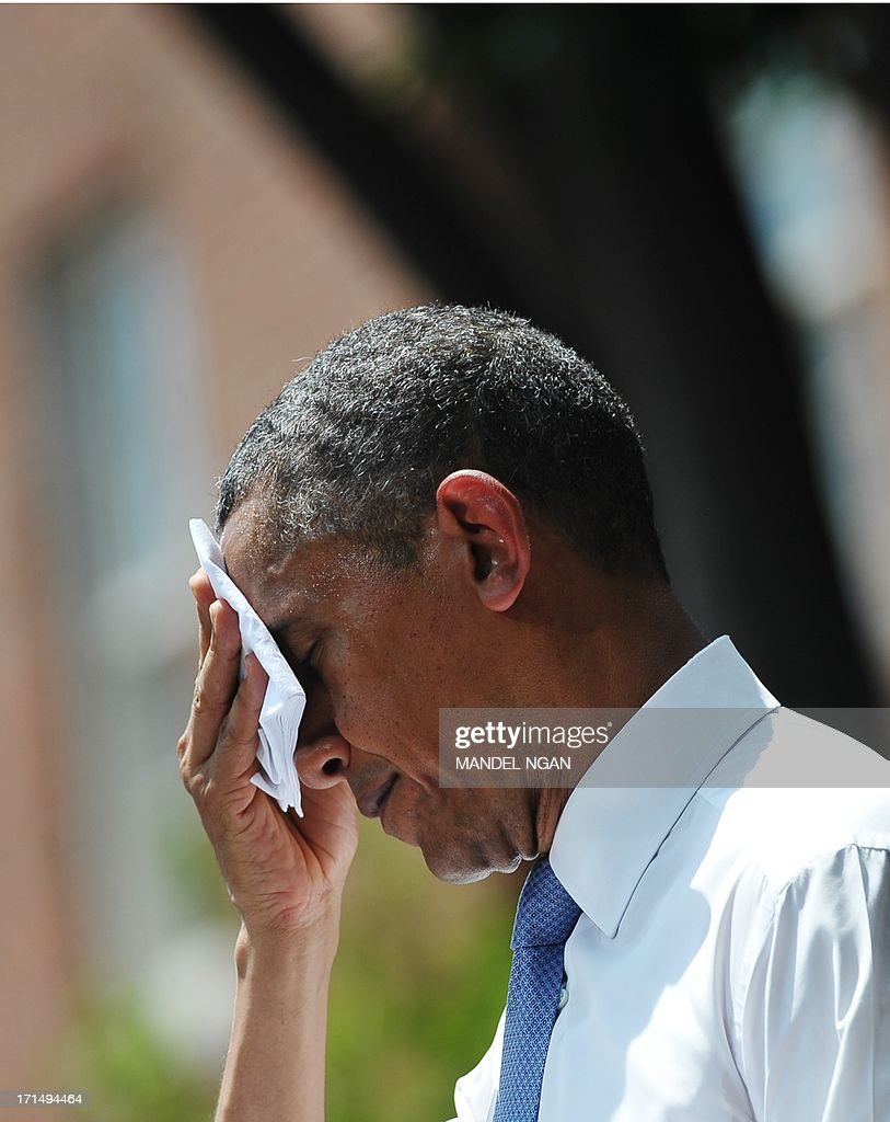 US President <a gi-track='captionPersonalityLinkClicked' href=/galleries/search?phrase=Barack+Obama&family=editorial&specificpeople=203260 ng-click='$event.stopPropagation()'>Barack Obama</a> wipes his brow as he speaks on climate change on June 25, 2013 at Georgetown University in Washington, DC. AFP PHOTO/Mandel NGAN
