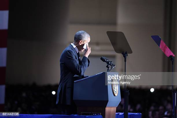 S President Barack Obama wipes his tears as he gives a speech during his farewell speech at McCormick Place in Chicago IL USA on January 10 2017...