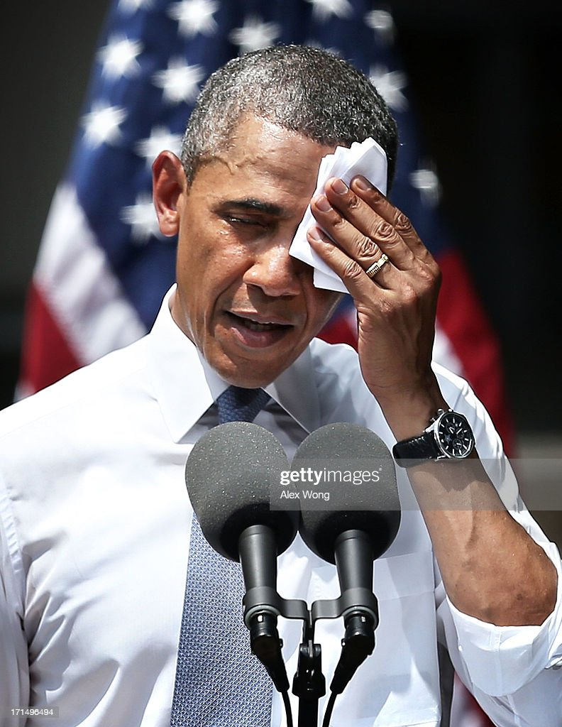 U.S. President <a gi-track='captionPersonalityLinkClicked' href=/galleries/search?phrase=Barack+Obama&family=editorial&specificpeople=203260 ng-click='$event.stopPropagation()'>Barack Obama</a> wipes sweat off his face as he unveils his plan on climate change June 25, 2013 at Georgetown University in Washington, DC. President Obama laid out his plan to diminish carbon pollution and prepare the country for the impacts of climate change.