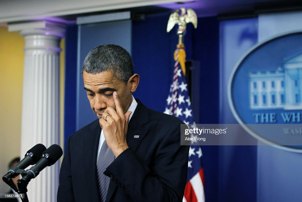 U.S. President <a gi-track='captionPersonalityLinkClicked' href=/galleries/search?phrase=Barack+Obama&family=editorial&specificpeople=203260 ng-click='$event.stopPropagation()'>Barack Obama</a> wipes tears as he makes a statement in response to the elementary school shooting in Connecticut December 14, 2012 at the White House in Washington, DC. According to reports, there are 27 dead, 20 of them children, after Adam Lanza opened fire at the Sandy Hook Elementary School in Newtown, Connecticut. Reports say that Lanza is dead at the scene and his mother, a teacher at the school, is also dead.