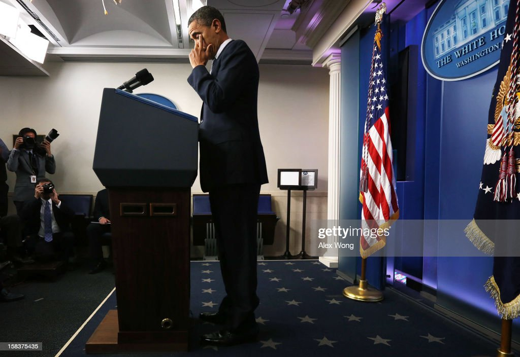 U.S. President <a gi-track='captionPersonalityLinkClicked' href=/galleries/search?phrase=Barack+Obama&family=editorial&specificpeople=203260 ng-click='$event.stopPropagation()'>Barack Obama</a> wipes tears as he makes a statement in response to the elementary school shooting in Connecticut December 14, 2012 at the White House in Washington, DC. There are 27 dead, 20 of them children, after Adam Lanza reportedly opened fire in one of the largest school massacres in U.S. history. Lanza is dead at the scene and his mother, a teacher at the school, is also dead.