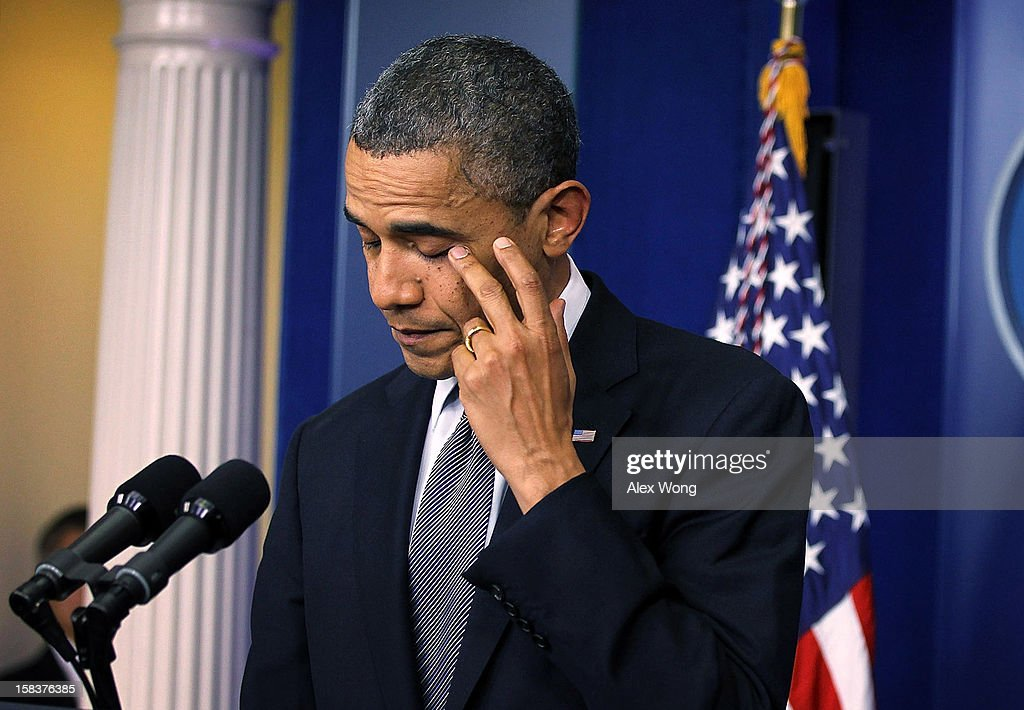U.S. President <a gi-track='captionPersonalityLinkClicked' href=/galleries/search?phrase=Barack+Obama&family=editorial&specificpeople=203260 ng-click='$event.stopPropagation()'>Barack Obama</a> wipes tears as he makes a statement in response to the elementary school shooting in Connecticut December 14, 2012 at the White House in Washington, DC. According to reports, there are 27 dead, including the shooter, 20 of them children, after Ryan Lanza, 24, opened fire in at the Sandy Hook Elementary School in Newtown, Connecticut. Reports say that Lanza was dead at the scene and his mother, a teacher at the school, is also dead. His brother has also been found dead in Hoboken, New Jersey.