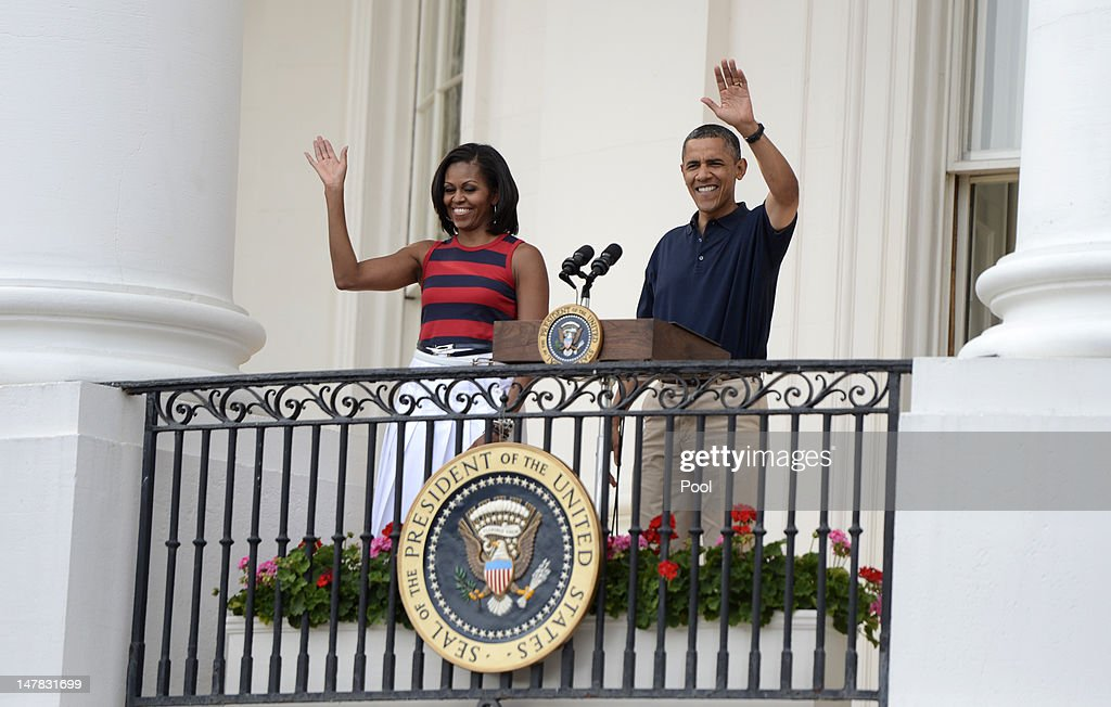 U.S. President <a gi-track='captionPersonalityLinkClicked' href=/galleries/search?phrase=Barack+Obama&family=editorial&specificpeople=203260 ng-click='$event.stopPropagation()'>Barack Obama</a>, with first lady <a gi-track='captionPersonalityLinkClicked' href=/galleries/search?phrase=Michelle+Obama&family=editorial&specificpeople=2528864 ng-click='$event.stopPropagation()'>Michelle Obama</a> delivers remarks to an Independence Day picinic on the South Lawn of the White House on July 4, 2012 in Washington, D.C. On this Independence Day President Obama is hosting a 4th of July celebration picnic on the South Lawn for White House staff and US service members.