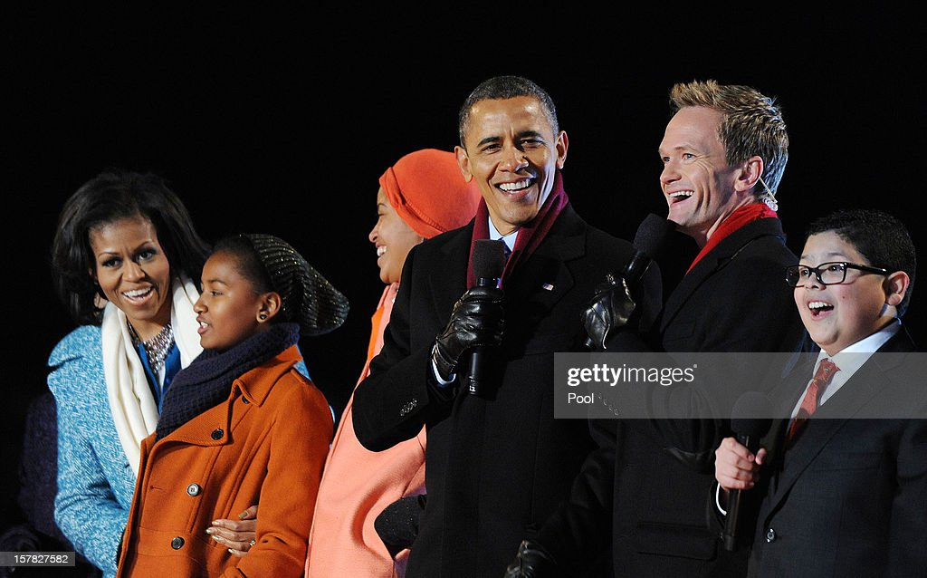 U.S. President Barack Obama (C) with his wife first lady Michelle Obama (L) and their daughters Malia and Sasha Obama (2nd L), sing on stage with actor Neil Patrick Harris (3rd R), Rico Rodriguez (2nd R) , actor on Modern Family during the 90th National Christmas Tree Lighting Ceremony on the Ellipse behind the White House on December 6, 2012 in Washington, DC. This year is the 90th annual National Christmas Tree Lighting Ceremony.
